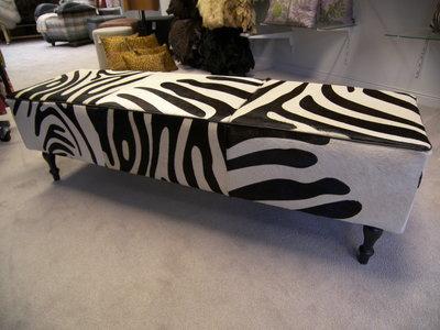 Poef koehuid met zebraprint